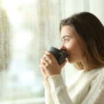 woman drinks coffee on a rainy day
