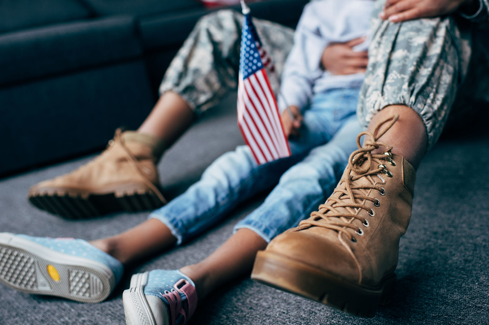mother and daughter in military uniform with american flag